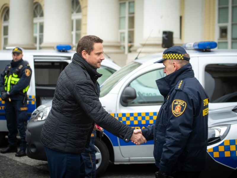 Mayor of Warsaw Rafał Trzaskowski gives electric car to eco patrol officer