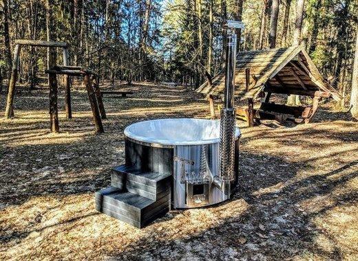 Medium black fiberglass lined hot tub with integrated burner wellness scandinavian 3