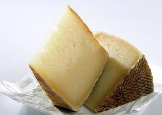 Thumb manchego cheese