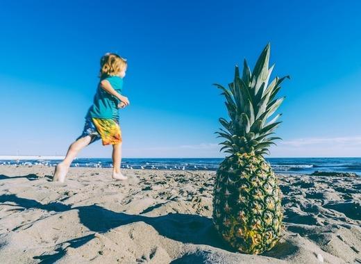 Medium child and a pineapple