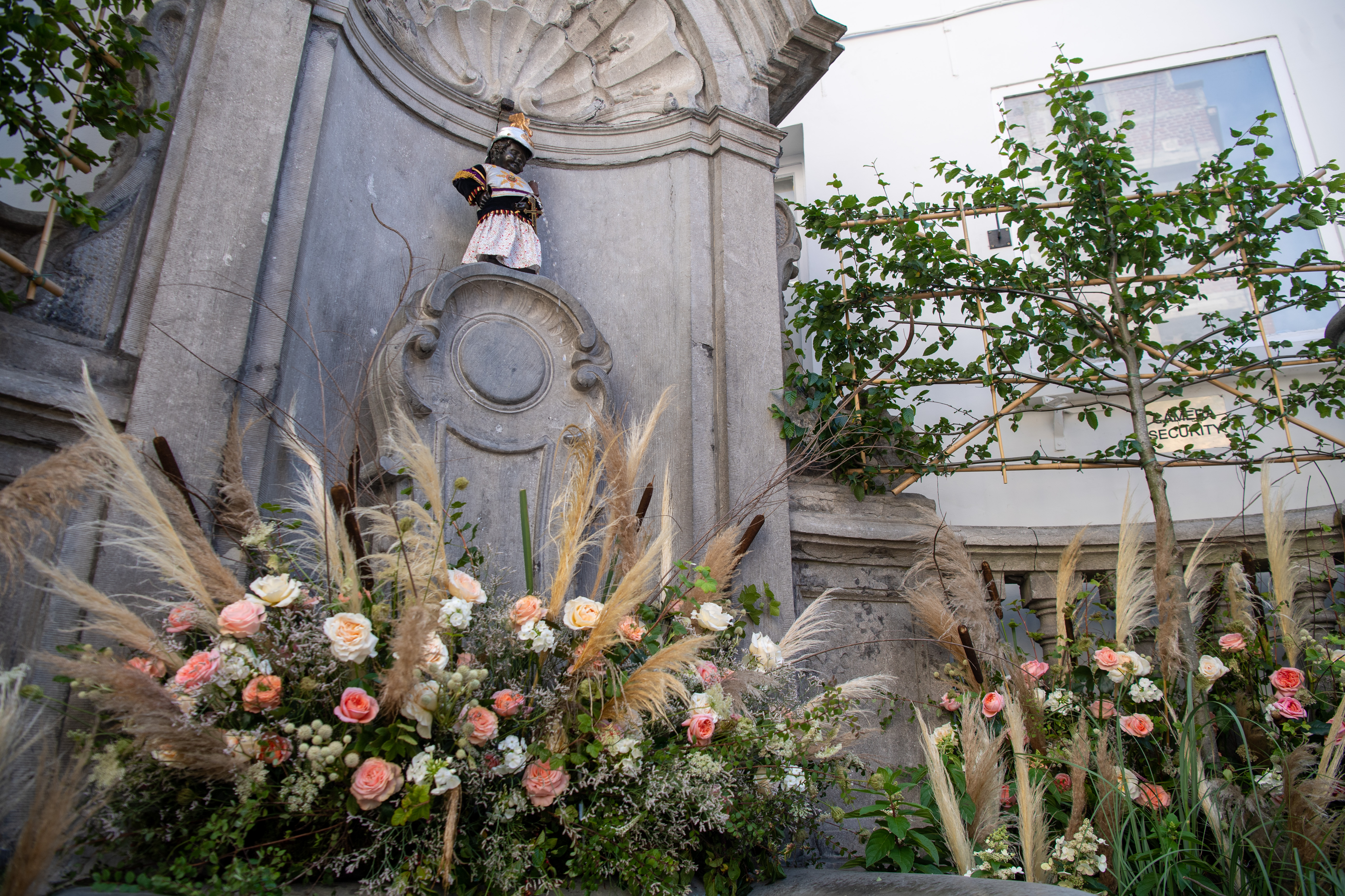 The Manneken-Pis surrounded with flowers